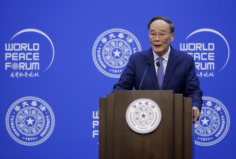 Chinese Vice President Wang Qishan delivers a speech at the opening of World Peace Forum in Beijing