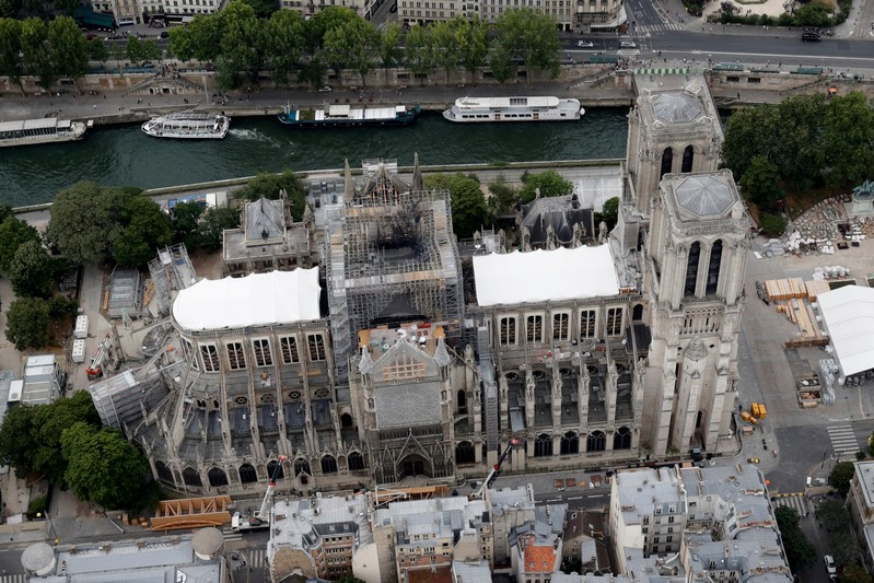 FILE PHOTO: A view shows the damaged roof of Notre-Dame de Paris during restoration work, three months after a fire that devastated the cathedral in Paris