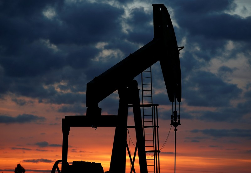 An oil pump is seen at sunset outside Vaudoy-en-Brie