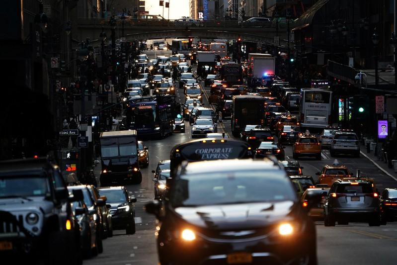 Traffic is pictured at twilight along 42nd St. in Manhattan
