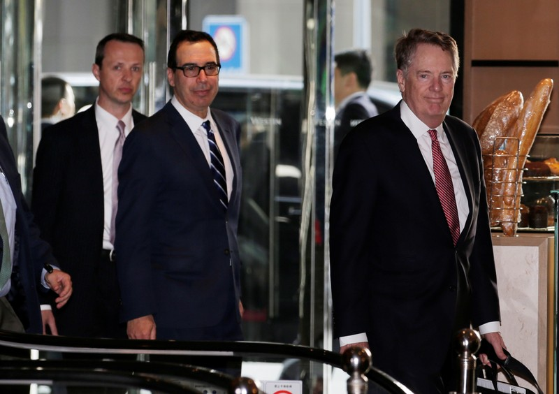 Members of the U.S. trade delegation Steven Mnuchin and Robert Lighthizer arrive at a hotel in Beijing