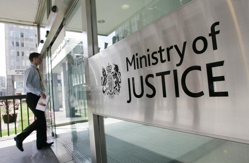 FILE PHOTO: A man enters The Ministry of Justice in London