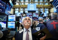 Wall St. falls as Apple drags, sharp rate cut hopes fade