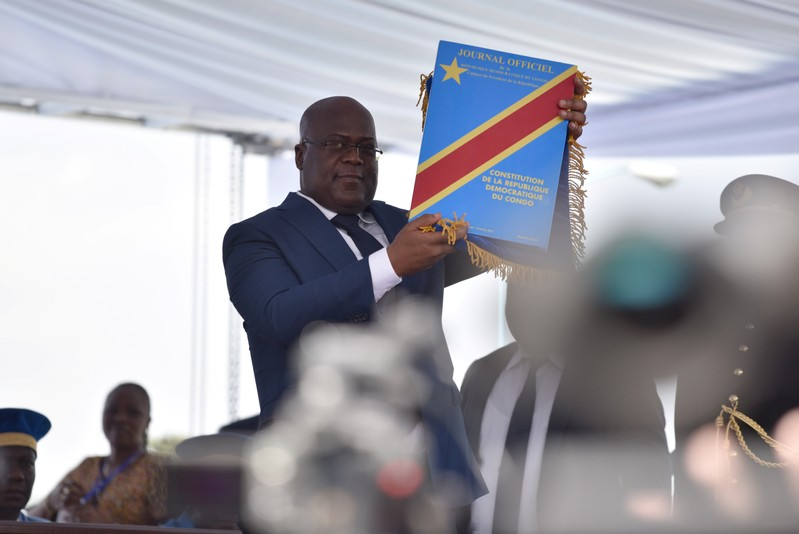 FILE PHOTO - Felix Tshisekedi holds up the constitution during the inauguration ceremony whereby Tshisekedi was sworn into office as the new president of the Democratic Republic of Congo at the Palais de la Nation in Kinshasa