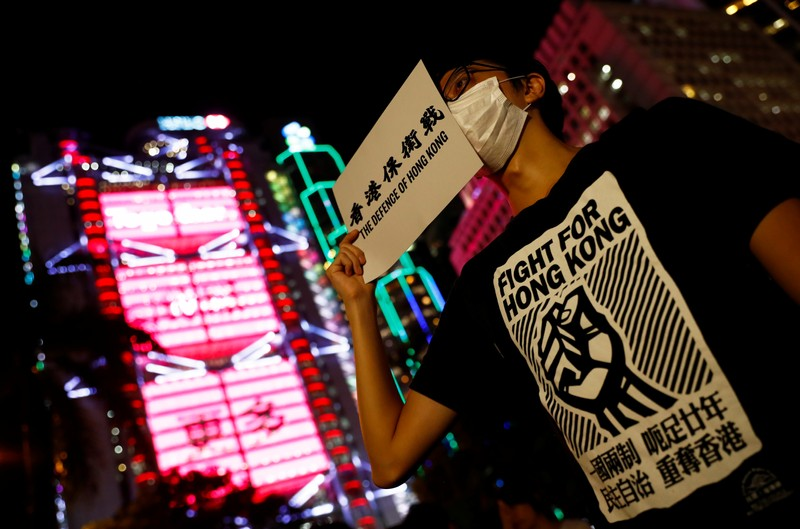 People attend a protest in Hong Kong
