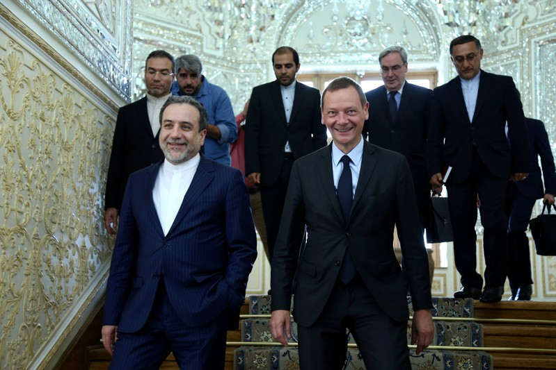 FILE PHOTO: Iran's deputy foreign minister, Abbas Araqchi, with visiting senior French diplomat Emmanuel Bonne in Tehran