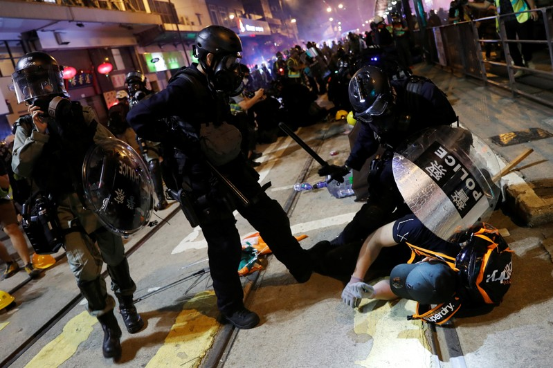 Riot police detains a demonstrator during a protest against police violence in Hong Kong