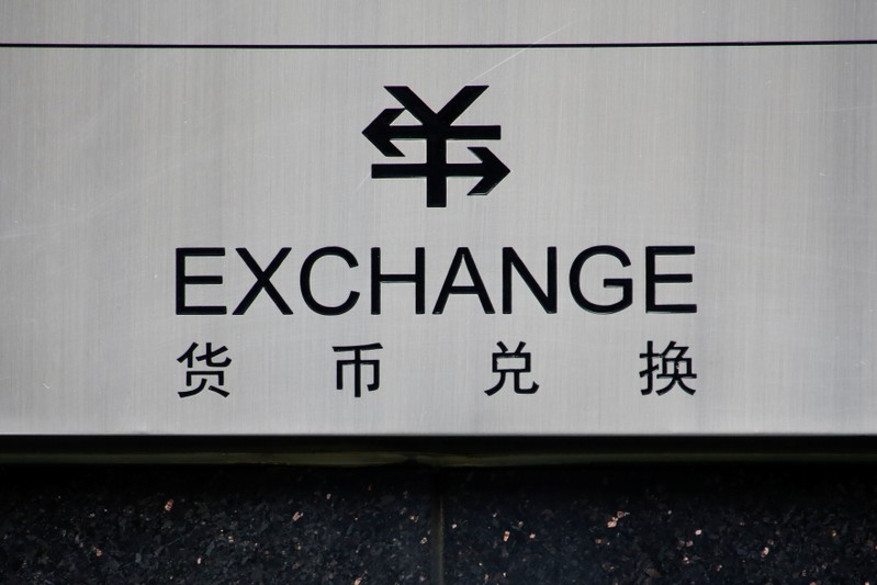 A sign for foreign currency exchange is seen at a branch of the ICBC bank in Beijing