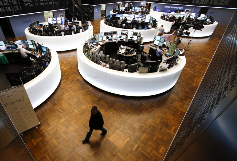 A trader walks across the trading floor at the Frankfurt stock exchange