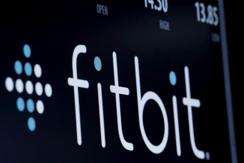 FILE PHOTO: The ticker symbol for Fitbit is displayed at the post where it is traded on the floor of the NYSE