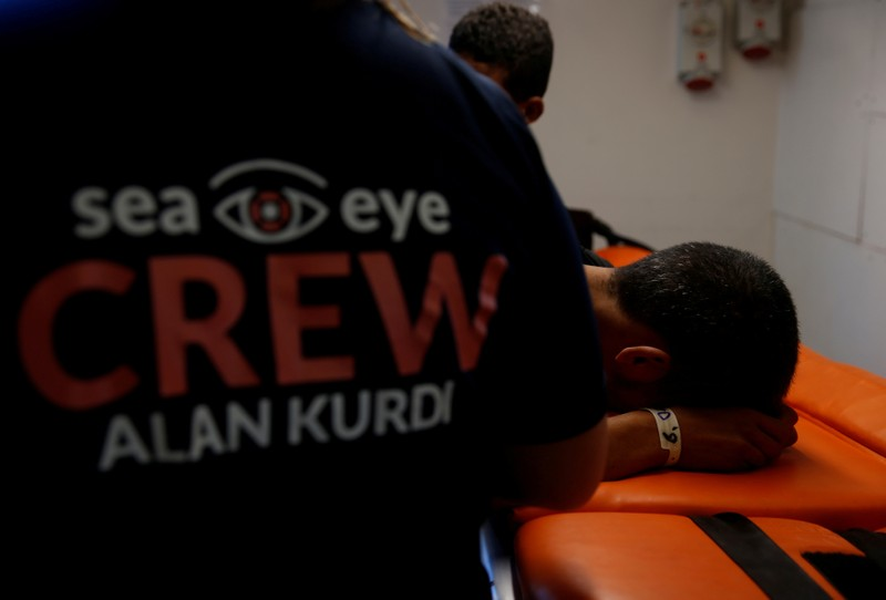 FILE PHOTO: An ill Tunisian migrant is treated in the clinic on the German NGO Sea-Eye migrant rescue ship 'Alan Kurdi' in international waters off Malta in the central Mediterranean Sea