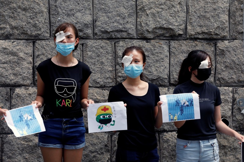 Medical students hold hands as they form a human chain during a protest against the police brutality, at the Faculty of Medicine in The University of Hong Kong