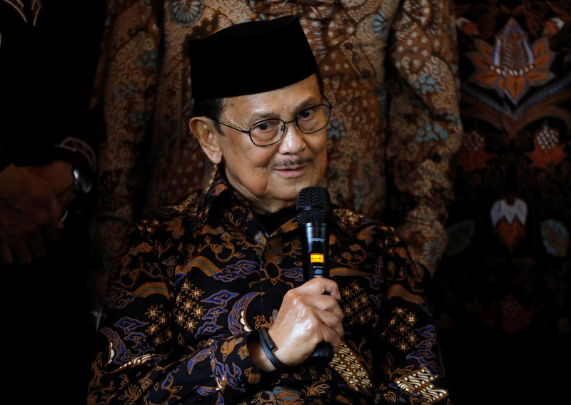 Former Indonesian President B.J. Habibie speaks with the media following his meeting with Malaysian politician Anwar Ibrahim at Habibie's home in Jakarta,
