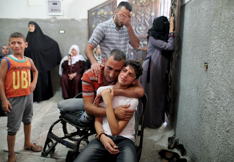 Relatives of Palestinian teenager Al-Ashqar, 17 mourn during his funeral in the northern Gaza Strip