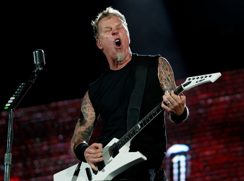 FILE PHOTO: James Hetfield, lead vocalist of the heavy metal group Metallica performs during their World Magnetic tour concert in Abu Dhabi
