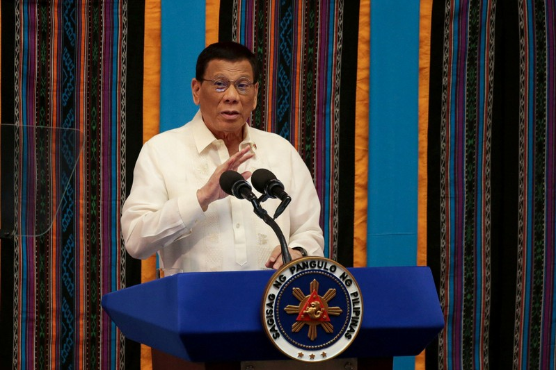 FILE PHOTO: Philippine President Rodrigo Duterte gestures during his fourth State of the Nation Address at the Philippine Congress in Quezon City