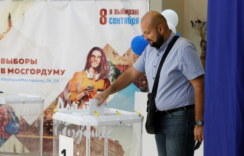 A man casts his ballot at a polling station during the Moscow city parliament election in Moscow
