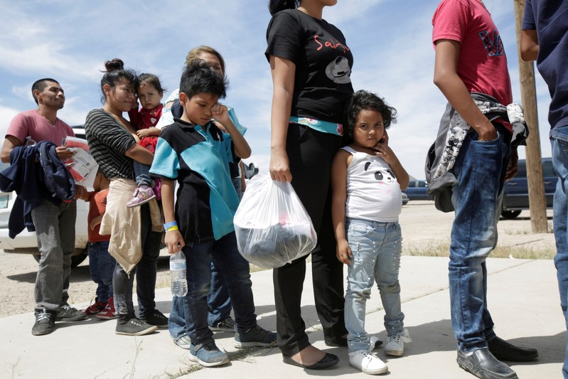 FILE PHOTO: Central American migrants stand in line before entering a temporary shelter, after illegally crossing the border between Mexico and the U.S., in Deming