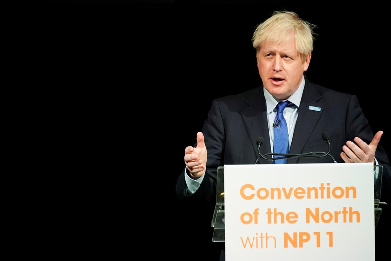 Britain's Prime Minister Boris Johnson gestures as he speaks during the Convention of the North at the Magna Centre in Rotherham