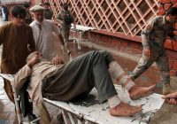Afghan official says mosque explosion kills 62