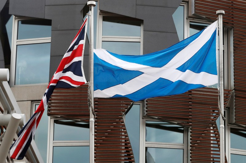 The Union Flag and The Saltire fly outside the Scottish Parliament in Holyrood Edinburgh, Scotland
