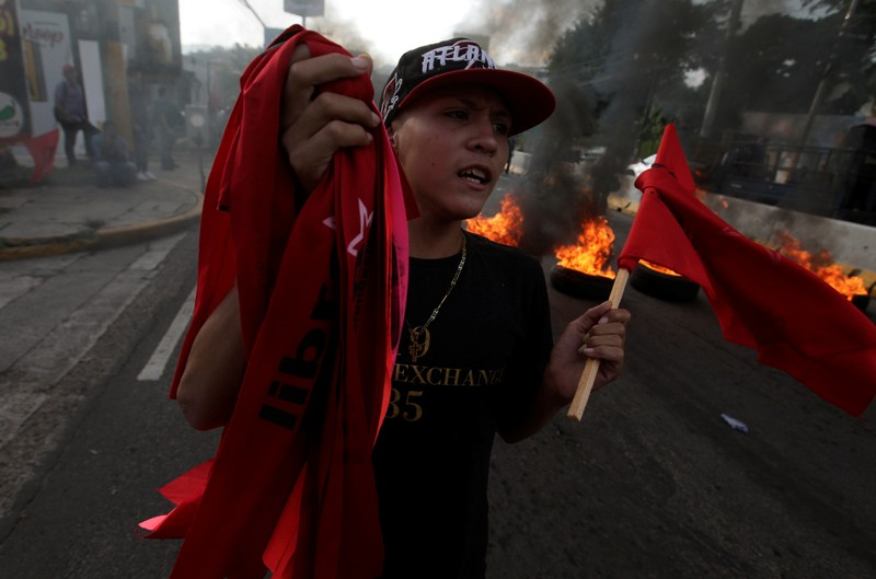 A demonstrator takes part in a protest against the government of president Juan Orlando Hernandez in Tegucigalpa