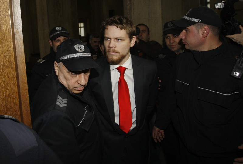 FILE PHOTO: Australian Palfreeman is escorted by Bulgarian policemen before start of hearing of his appeal case in Court of Appeal in Sofia