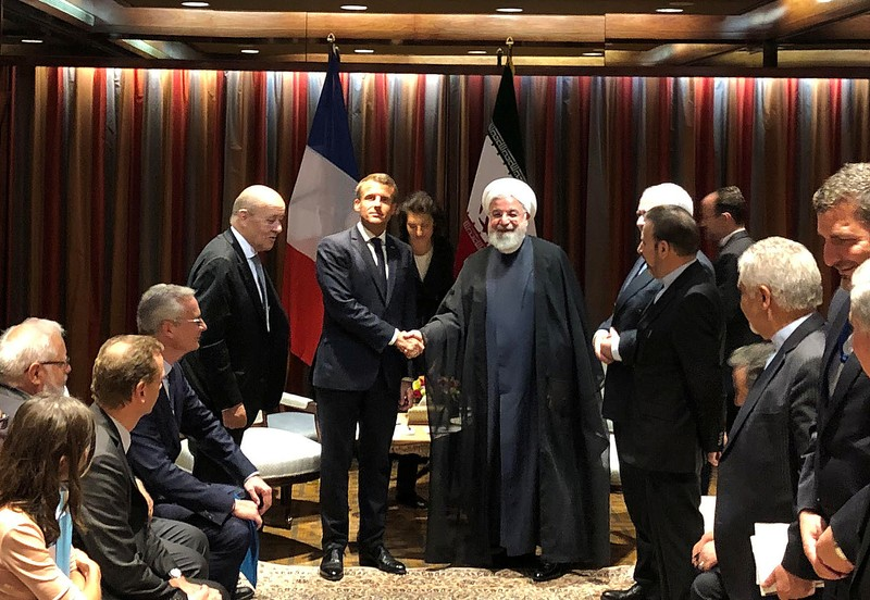 French President Emmanuel Macron shakes hands with Iranian President Hassan Rouhan in New York