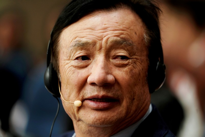 FILE PHOTO: Huawei founder Ren Zhengfei attends a panel discussion at the company headquarters in Shenzhen