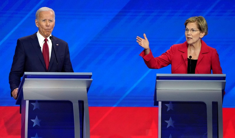 FILE PHOTO: Former Vice President Joe Biden listens as Senator Elizabeth Warren speaks in the final minutes of the 2020 Democratic U.S. presidential debate in Houston