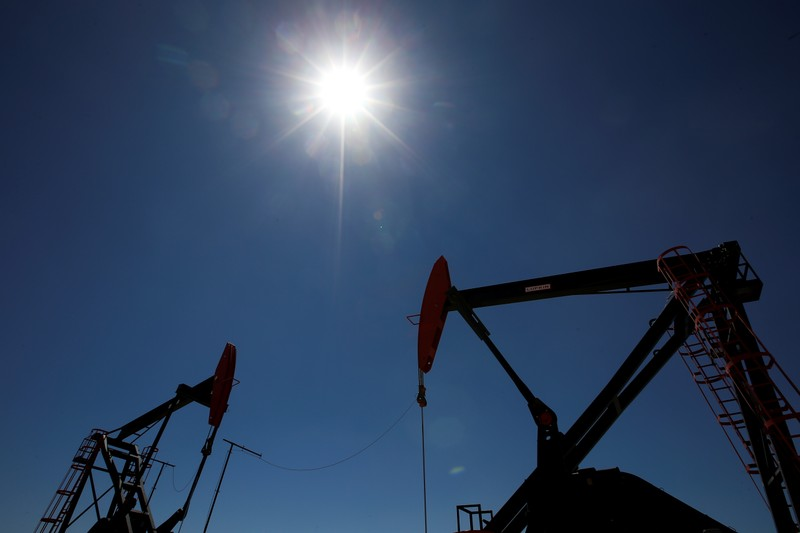 FILE PHOTO: Oil rigs are seen at Vaca Muerta shale oil and gas drilling, in the Patagonian province of Neuquen
