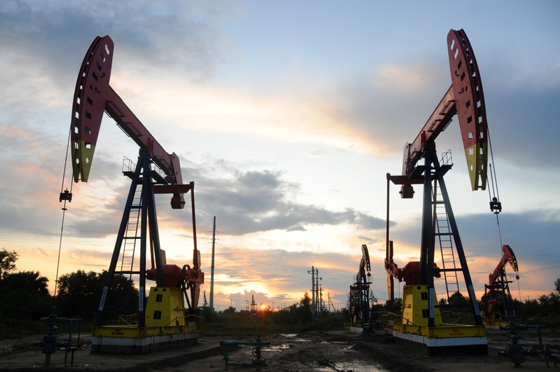 Pumpjacks are seen during sunset at the Daqing oil field in Heilongjiang