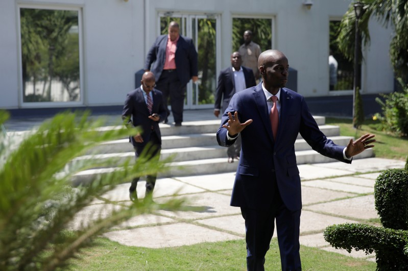 Haiti's President Jovenel Moise gestures as he arrives to a news conference in the gardens of the National Palace of Port-au-Prince
