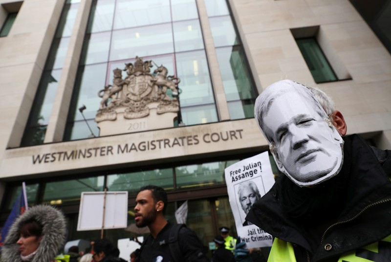 Supporters of WikiLeaks founder Julian Assange protest outside of Westminster Magistrates Court in London