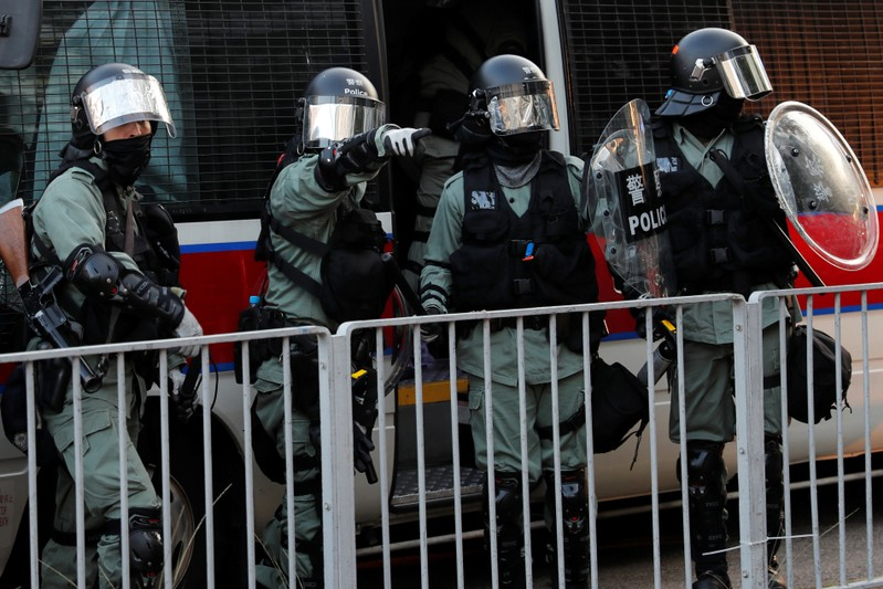 Riot police officers are seen during an anti-government demonstration in Sha Tin, Hong Kong