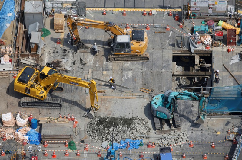 FILE PHOTO: Heavy machinery is seen at a construction site in Tokyo