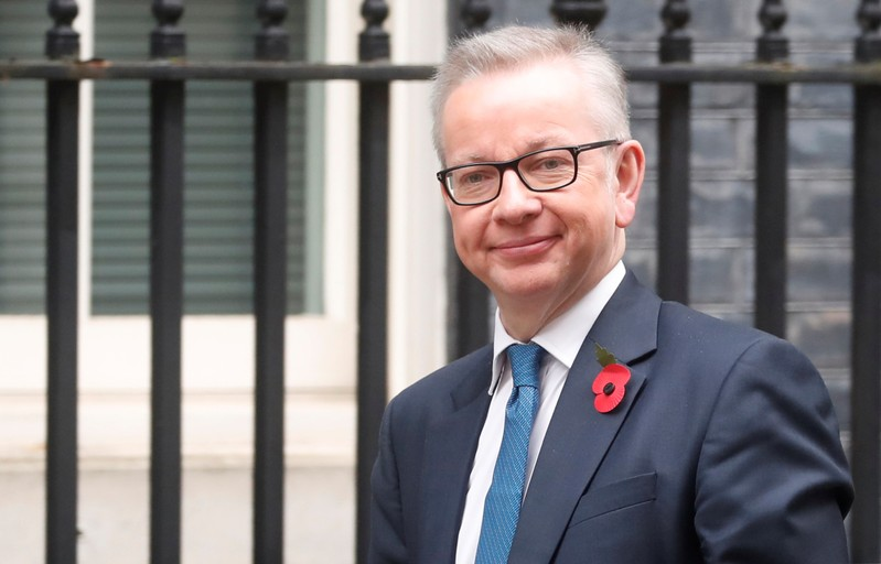 FILE PHOTO: Chancellor of the Duchy of Lancaster Michael Gove is seen outside Downing Street in London