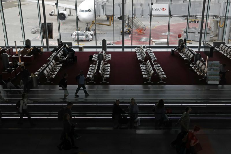 Passengers wait for their planes at the Paris Charles de Gaulle airport in Roissy