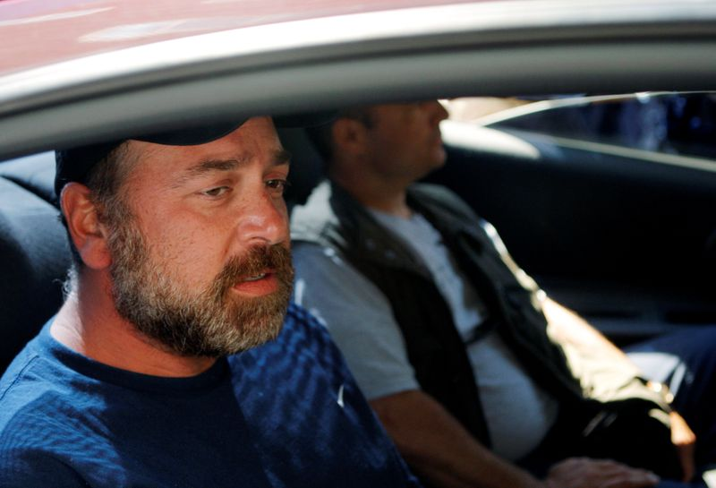 FILE PHOTO: Former hedge fund manager Samuel Israel III (L) is driven away by federal law enforcement officials in Springfield, Massachusetts, in 2008