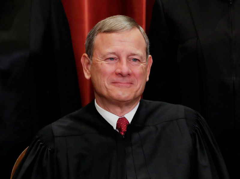 FILE PHOTO: U.S. Supreme Court Chief Justice John Roberts poses during group portrait at the Supreme Court in Washington