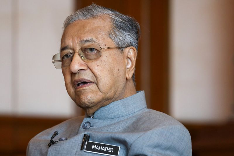 Malaysia's Prime Minister Mahathir Mohamad speaks during an interview with Reuters in Putrajaya