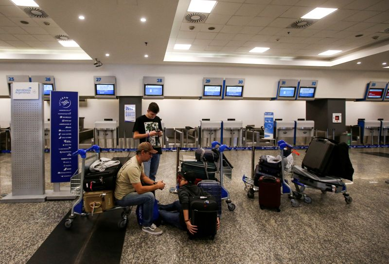 Passengers wait at Buenos Aires' airport as flights were cancelled during a 24-hour strike called by Argentina's state-owned airline Aerolineas Argentinas pilots and other personnel at Buenos Aires