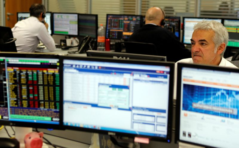 Traders work at Mirae Securities in Sao Paulo