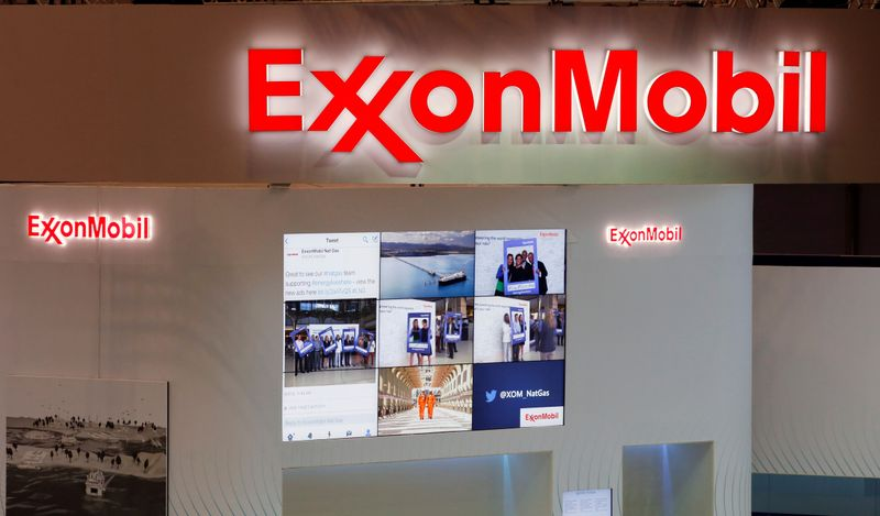 seFILE PHOTO: Logos of ExxonMobil are seen in its booth at Gastech, the world's biggest expo for the gas industry, in Chiba