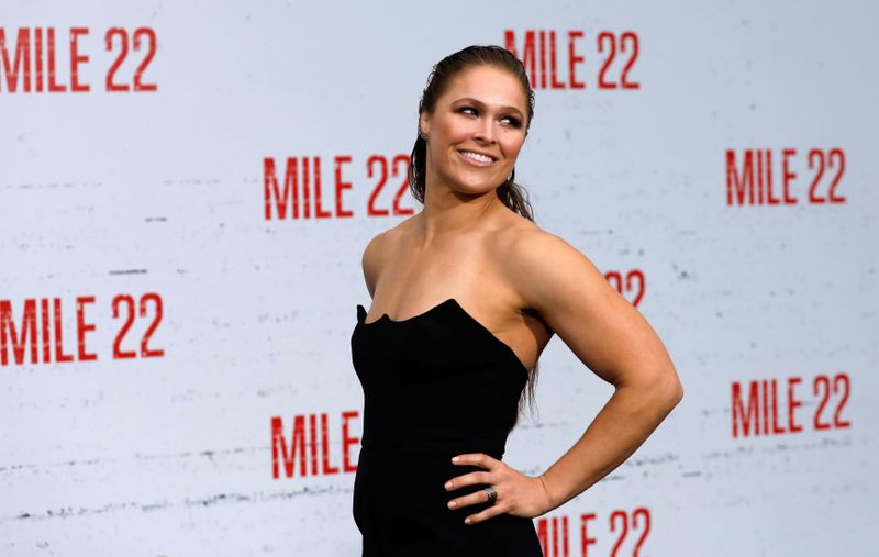 Cast member Rousey poses at the premiere for