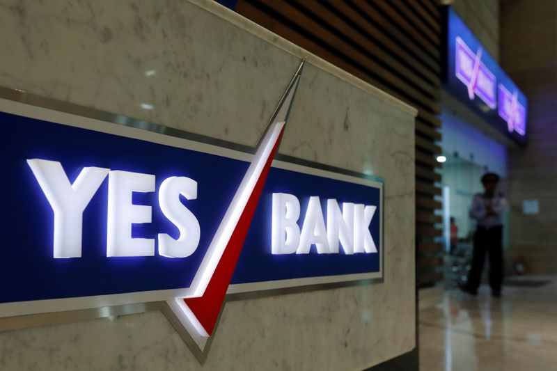 A security guard stands outside a Yes Bank branch at its headquarters in Mumbai