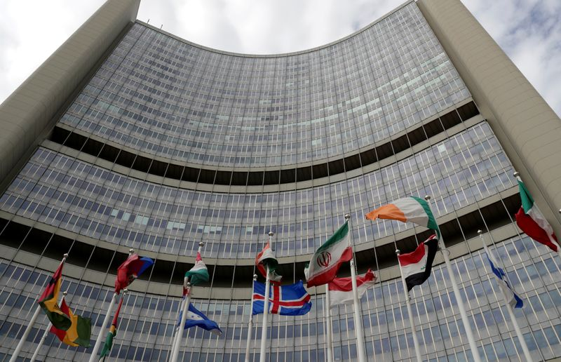 An Iranian flag flutters amongst other flags in front of the IAEA headquarters in Vienna