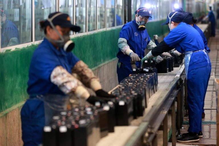A private survey shows China's manufacturing activity expanded slightly in March