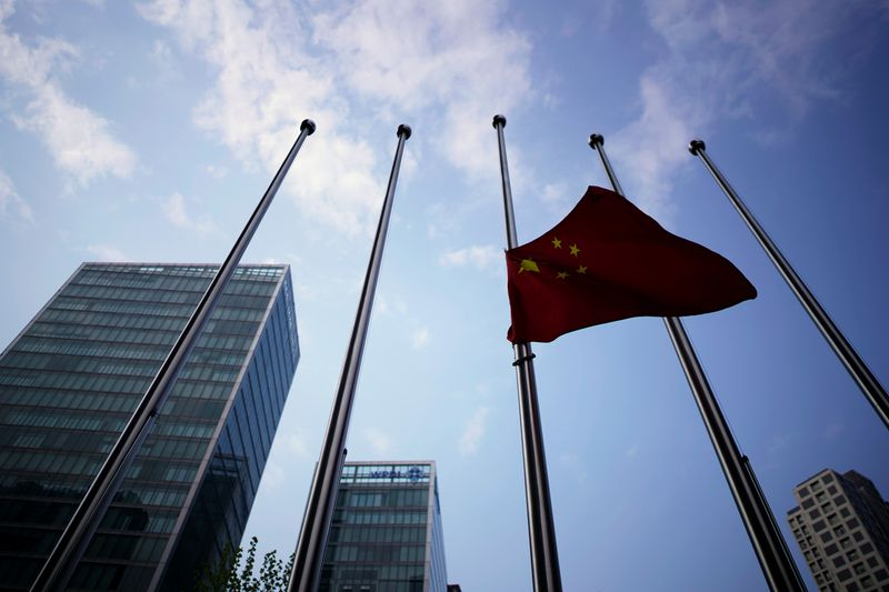 The Chinese national flag flies at half-mast near a hotel in Wuhan