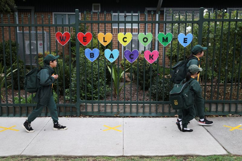 Children return to campus for the first day of New South Wales public schools fulling re-opening in Sydney